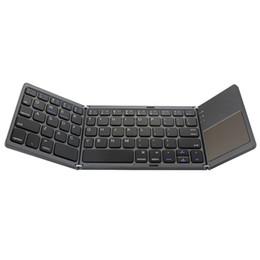 Toptan satış A18 Taşınabilir Iki Kez Katlanır Bluetooth Klavye BT Kablosuz Katlanabilir Touchpad Tuş IOS Android Smartphone Windows için Ipad Tablet