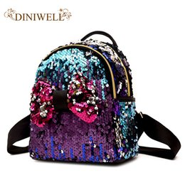 China DINIWELL Women's backpack promotion new fashion sequin bow female backpack girl teen children's bag mini kawaii small backpack suppliers