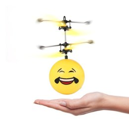 wholesale toys helicopter NZ - New Interesting LED Flashing Infrared Induction Helicopter Flying Ball Flash Disco RC emoji Magic DIY Ball Stage Lamp Child Toys