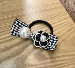 $enCountryForm.capitalKeyWord NZ - Hot sale ! New 2019 CC Fashion Internet celebrities black and white camelliae flowers pearl hair band Korean version leather tendons hair ro