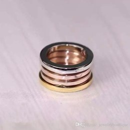Real Engagement Rings China NZ - 2017 Brand name 316L Stainless Steel Rings with three colors real gold Plated Women and Men Rings Fashion Wedding Jewelry PS5486