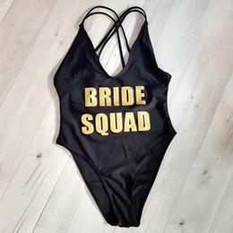 5a1249a21b6 Bride Squad Team Letter Printing One Piece Swimsuit Back Cross High Cut  Women Swimwear Red Black Monokini Beach Wear Mayo Blue Y19052101
