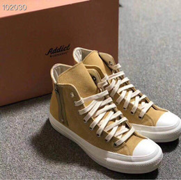 Spring Fall Canvas Shoes Australia - Spring 2019 new men's and women's Hong Kong style camo canvas shoes for women's high-top shoes for men's versatile sports casual shoes a33