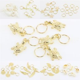 Discount left hand hair - 50Pcs Bag New Gold Shell Hands Leaves Star Conch Snowflake Pendant Charms Rings Set Hair Clips For For Braid Hair Access