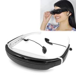 Опт Портативные очки 16: 9 Virtual HD Широкоэкранный мультимедийный плеер VG320 3D-стерео видео очки Мобильный кинотеатр 4 ГБ Интерфейс HDMI