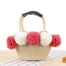 $enCountryForm.capitalKeyWord Australia - Factory wholesale women handbag summer new cute contrast big wool ball straw bag outdoor holiday beach bag sweet cute fur ball handbag