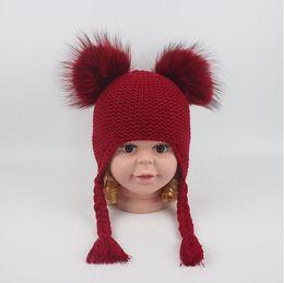 Street Children Cap NZ - 6 Colors Children Cute Winter Hats Two Faux Raccoon Fur Pompom Hat Baby Knitted Cap Warm Ears Earflap Thick Kids Beanies CCA10952 10pcs