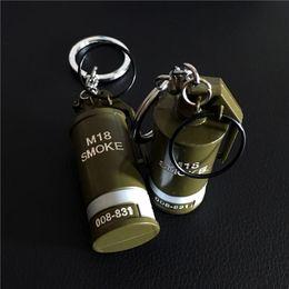$enCountryForm.capitalKeyWord Australia - Super Cool PUBG Game Props Model Keychain Weapon Toy Smoke Bomb Metal Key Ring Weapon Model Military Fans Keychain Games Jewelry