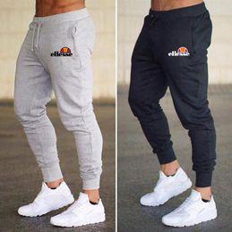 Erkek Joggers Rahat Pantolon Spor Spor Dipleri Sıska Sweatpants Pantolon Siyah Spor Jogging Yapan Vücut Geliştirme Parça Pantolon indirimde