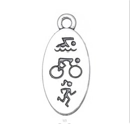 Running Charms Wholesale Australia - Myshape Wholesale,Double Side Triathlon Swimming Cycling Running Athlete Engraved Oval Charms Sports Style Wholesale 20pcs