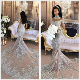 eef63989b74 Dubai Arabic Luxury Sparkly Wedding Dresses Sexy Bling Beaded Lace Applique  High Neck Illusion Long Sleeves Mermaid Chapel Bridal Gowns 2K19