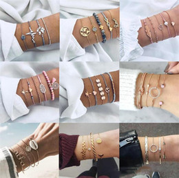 $enCountryForm.capitalKeyWord NZ - 4 Pcs  Set Classic Arrow Knot Round Crystal Multilayer Adjustable Open Bracelet Set Women Fashion Party Jewelry Multiple Styles