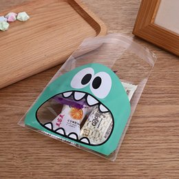 $enCountryForm.capitalKeyWord NZ - 100pcs Cute Cartoon Monster Cookie Candy Bag Self Adhesive Plastic Packing Bag Wedding Party Biscuits Baking Package Supplies