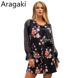 0aa920ca683 Aragaki Jumpsuits Women Casual Loose Rompers 2019 Spring Floral Print Sexy  Long Sleeve Playsuit Short Jumpsuits Plus Size LN698