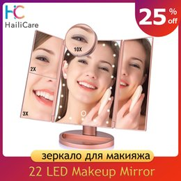 magnifying lights NZ - 22 LED Touch Screen Makeup Mirror 1X 2X 3X 10X Magnifying Mirrors 4 in 1 Tri-Folded Desktop Mirror Lights Health Beauty Tool Y200114