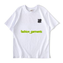 cb260381022c Fashion Undefeated Short-sleeved 18ss Round Neck Short-sleeved Mens Color  Hand-painted Graffiti T-shirt Men Women Couple Models Short Sleeve
