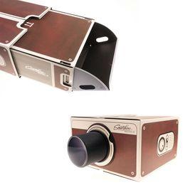 Mini Telefone Móvel Projetor Portátil Cinema Projeção DIY Smartphone projetor de telefone Móvel para Casa Projetor de Vídeo de Áudio Presente Top