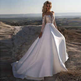spring modest Canada - Modest Long Sleeves A-Line Satin Lace Wedding Dresses 2020 Sheer Illusion Bridal Gowns Spring Beach Wedding Wear Custom Robe De Mariee