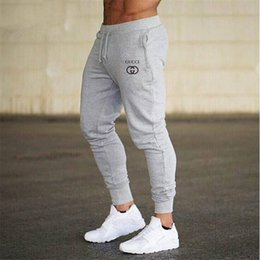 Wholesale designer joggers luxury pants shorts Fitness Men Sportswear Tracksuit Bottoms Skinny Sweatpants Trousers Black Gyms Jogger Track Pants