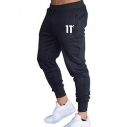 Venta al por mayor de 2019 nuevos hombres de moda gimnasio entrenamiento culturismo ropa de algodón pantalones de chándal para hombre Joggers pantalones pantalones pitillo pantalones de algodón