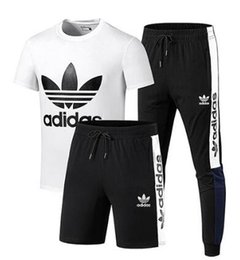 leisure men sport suits NZ - New men and women fashion Short sleeved shorts trousers boys girls Sports Leisure Three piece suit T-shirt shorts pants #7188