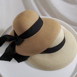 42830ff84ac4a Bell-shaped straw hat female big bow knot sunscreen Beach Hat for seaside  holiday in spring and summer