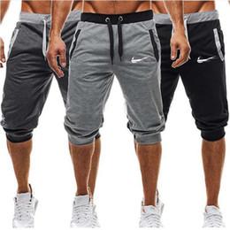 Wholesale men sports clothes pants resale online – 2019 new fashion shorts sports men s casual pants cotton sweatpants men s running shoes printed hip hop clothing
