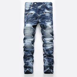 d96780ba3c Estilo francés Los hombres de la moda de los pantalones vaqueros de alta  calidad de color azul flaco en forma empalmado Ripped Jeans High Street  Destruido ...