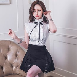 sexy suit bowknot Australia - Sleeveless Ruffle Bowknot White Blouse Top + Hollow Out Lace Patchwork Black Pleated Skirt Women Two Pieces Sets Sexy Suit Dress T200528