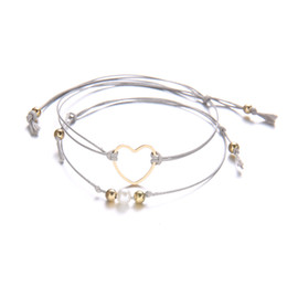 China 2Pcs set Charm Braided Rope Pearl Heart Bangle Bracelet Elegant Hollow Hearts Multi-layer Weave Ropes Anklets Bracelets Women Jewelry suppliers