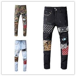 Leopard men s pants online shopping - Mens luxury designer black jeans camouflage ripped skinny jeans pants Leopard patchwork mens designer pants rivet motorcycle jeans D30