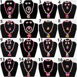 Nouveau 10pcs / lot enfants ensemble de bijoux chaîne en plastique Cartoon Set quatre pièces ensemble de bijoux perle Bracelet boucles d'oreilles anneau collier bijoux