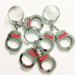 Party favor holders online shopping - Fashion Handcuff Shape Key Ring Alloy Keys Holder Sup Brand Couple Keychain For Party Favor New Arrival txa E1