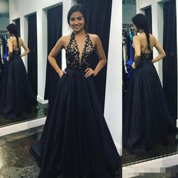 cc2d5802ba 2019 Sexy Black Backless A Line Prom Dresses Halter Lace Applique Plunging  V Neck Satin Long Formal Evening Party Ball Gown with Pockets