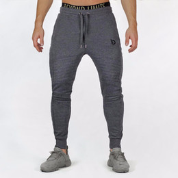 Discount tight exercise pants - Mens Jogger Fitness Pants Casual Stretch Cotton Mens Fitness Exercise Embroidered Tights Sports Pants Jogging Asian Size