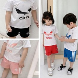 7811cd4e7 Kids Designer Clothes Set Boys Girls AD Letter Summer T shirt + Shorts  Tracksuit 2 Piece Brand Short Sleeve Sportswear Outfit Beach C52501