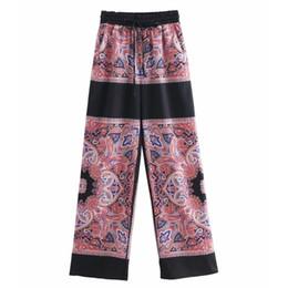 10b909ab4 Women Vintage Totem Floral Print Wide Leg Pants Retro Chic Elastic Waist  Lace Up Trousers Patchwork Pantalones Mujer Pants P287 Q190430