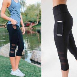 c09117bb3e68 Yoga Pants Running Sports Leggings Side Pocket Cell Phone Capri Pants Women  Workout Gym Tight Trousers