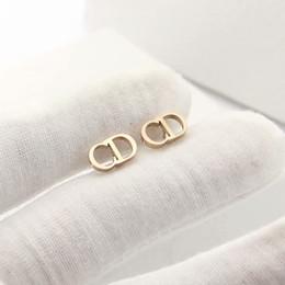 joyería de diseñador de lujo pendientes de mujer letra CD stud pendientes Acero inoxidable plata oro rosa 18k oro elagant Alfabeto stud estilo de moda en venta
