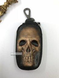 Ingrosso Custodia originale chiave Skull auto piccola borsa a mano in pelle Stereo fatto Carving Uomo Donna Pochette Bachelor Party Gifts