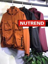 $enCountryForm.capitalKeyWord Australia - Men's designer coats luxury windbreaker jacket hooded detachable multi pocket tooling couple armband LOGO fashion wide coat