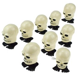wholesale skull toys Australia - 200pcs lot New Clockwork Jumping Skull Wind Up Bounce Toy Props Toy Party Halloween toys tricky Gift
