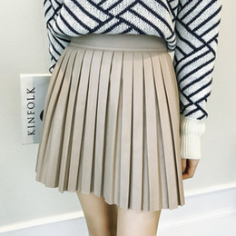 0b7880234f 2018 Apricot New Empire None Hot Sale All-match Solid Faux Leather Skirt  Thin High Waist Short Skirts Pleated Mini Length S-5xl Y19060301