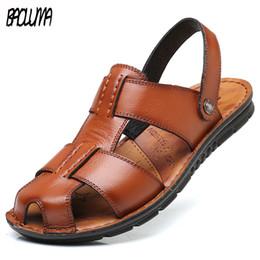 560b67eef Горячие 2019 Большой Размер мужские Сандалии Лето Британская Мода Человек  Кожаные Пляжная Обувь Мужчины Массаж Нескользящие Большие Тапочки Квартиры