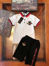 wholesale polo fashion sport NZ - Top Quality Kids Sports Clothing Sets Designer 100% Cotton Soft Boys School Wearing Summer Fashion Boys Girls Polo Top and Shorts 2 pcs Set