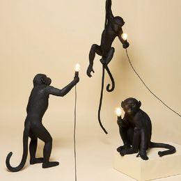 Moderno Mono Negro Cuerda de Cáñamo Colgante Ligero Moda Arte Simple Replicas Nórdicas Resina Seletti Lámpara Colgante Mono en venta