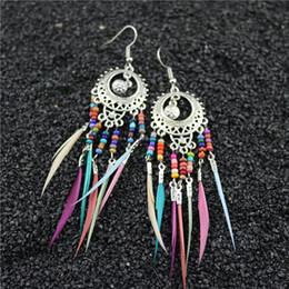 $enCountryForm.capitalKeyWord Australia - Hollow Oval Stud Earrings Retro Bohemian Designer Earrings Colorful Rice Beads Women Earrings Unique Feather Tassel Earring Alloy Hot Sale