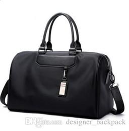 China HOT 2019 new fashion men women travel bag duffle bag, brand designer luggage handbags large capacity sport bag suppliers