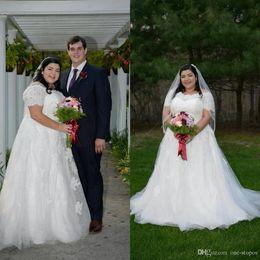 Short Plus Size Camo Wedding Dresses Australia - 2019 Plus Size Wedding Dresses Scoop Neck Short Sleeve Lace Appliques Bridal Gowns Court Train Beach A Line Wedding Dress