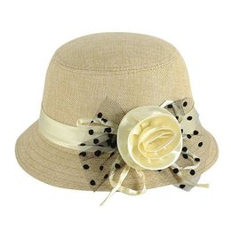 f9a29dc79ab Dome Wide Brim Sunshade Ultraviolet Proof Sunlight Hats Bow Pure Color  Cotton Material Manual Rose Hat New Arrival 6 3mmE1